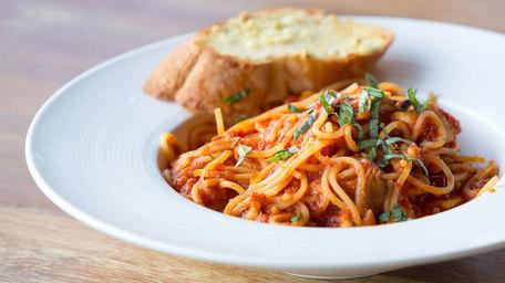 Spaghetti with Tomato, Olives, Mozzarella and Garlic, served with Garlic Bread